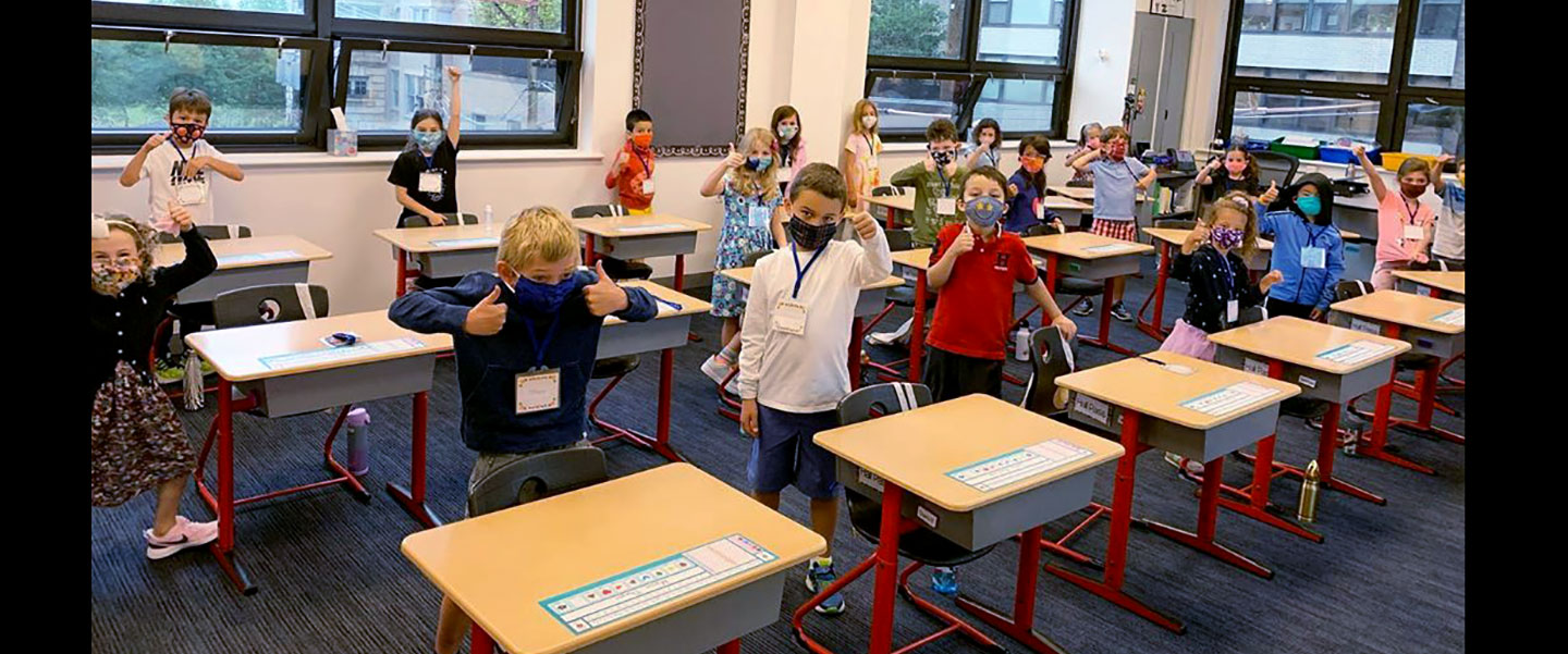 lower school students with masks at desks